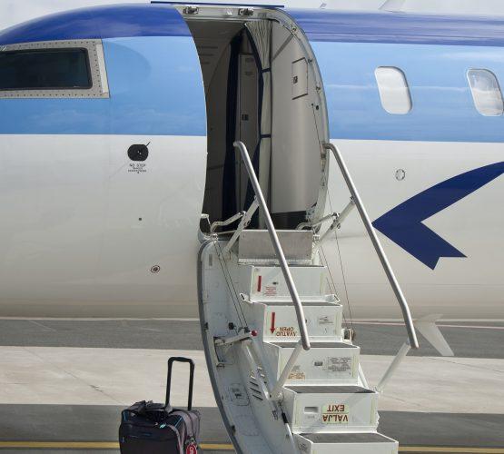 Luggage Near Airplane Steps